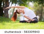 yoga outdoor. happy woman doing ... | Shutterstock . vector #583309843