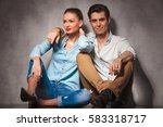 smiling couple sitting embraced ... | Shutterstock . vector #583318717