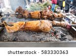 lamb on a spit selective focus   | Shutterstock . vector #583330363