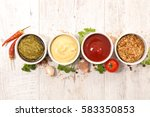 assorted dip and sauce | Shutterstock . vector #583350853