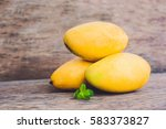 Mango Fruit On The Wooden Tabl...