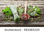 herbs and spices on a wooden... | Shutterstock . vector #583385233
