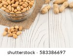 salted peanuts in a glass bowl...   Shutterstock . vector #583386697