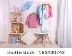 children clothing on hanger... | Shutterstock . vector #583430743