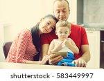 family watching a cartoon on a... | Shutterstock . vector #583449997