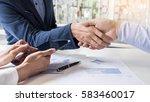 business handshake of two men...   Shutterstock . vector #583460017