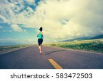 young fitness woman trail... | Shutterstock . vector #583472503