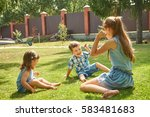 Small photo of happy playful children outdoors in the summer on the grass in a backyard