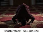 muslim praying humbly | Shutterstock . vector #583505323
