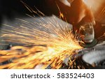 grinding and sparks | Shutterstock . vector #583524403