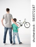 back view of father and son...   Shutterstock . vector #583572187