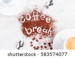 Small photo of coffee break concept - cups of espresso, spoons and coffee break lettering
