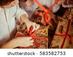 opening presents close up | Shutterstock . vector #583582753