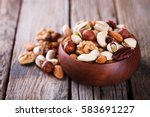nuts mixed in a wooden plate...   Shutterstock . vector #583691227