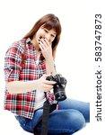 attractive brunette in jeans... | Shutterstock . vector #583747873
