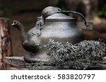 still life old aluminium kettle ...   Shutterstock . vector #583820797