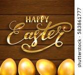golden easter eggs on a wooden... | Shutterstock .eps vector #583861777