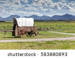 Covered wagon against a...
