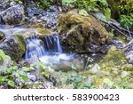 waterfall mountain river | Shutterstock . vector #583900423