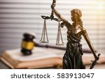 judge's gavel with statue of... | Shutterstock . vector #583913047