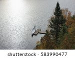 autumn canoeing on lake la haie ... | Shutterstock . vector #583990477