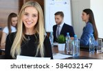 business woman with her staff ... | Shutterstock . vector #584032147