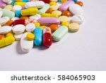 multicolored pills and tablets... | Shutterstock . vector #584065903