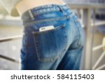 girl in blue jeans with modern... | Shutterstock . vector #584115403