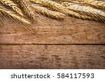 wheat ears on the wooden table | Shutterstock . vector #584117593