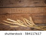 wheat ears on the wooden table | Shutterstock . vector #584117617