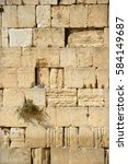 Small photo of Yerushalayim, Judea, Middle East. Famous antique site state relic place built by Herod in capital city. Past israelite divine blocks with faith prayers crying lament symbol letters. Pattern view