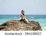 i sit on the rocks overlooking... | Shutterstock . vector #584158027