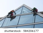 Window Washers Cleaning The...