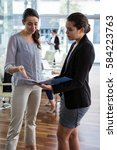 businesswomen having discussion ... | Shutterstock . vector #584223763