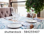 cafe table served with flowers... | Shutterstock . vector #584255407
