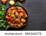 beef stew with potatoes ...   Shutterstock . vector #584260273