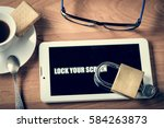 tablet and padlock on the...   Shutterstock . vector #584263873