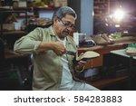 Shoemaker Repairing A High Hee...