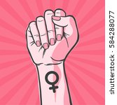 symbol of feminist movement.... | Shutterstock .eps vector #584288077