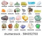Small photo of geological collection of various mineral stones with descriptions - fluorite, hematite, phlogopite, halite, danburite, petalite, castorite, heliodor, aquamarine, morganite, orpiment, realgar, etc