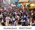 hong kong   apr 23  2016  crowd ... | Shutterstock . vector #584373463