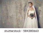 stunning blond bride holding...   Shutterstock . vector #584380663