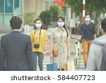 asian people in the street... | Shutterstock . vector #584407723