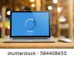 laptop on table with updating...   Shutterstock . vector #584408653