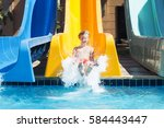 boy has a good time in aquapark ... | Shutterstock . vector #584443447