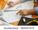 architect point at blueprint ... | Shutterstock . vector #584457673