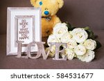 a word love made of wood  white ... | Shutterstock . vector #584531677