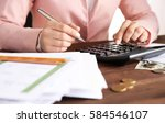 woman sitting at table with... | Shutterstock . vector #584546107