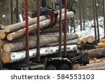 loading logs a crane. logging...   Shutterstock . vector #584553103