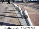 Row Of Metal Parking Poles For...